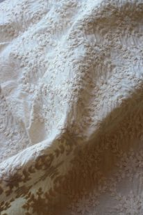 Organic tea-dyed embroidered cotton voile for 'petals' bustle overskirt