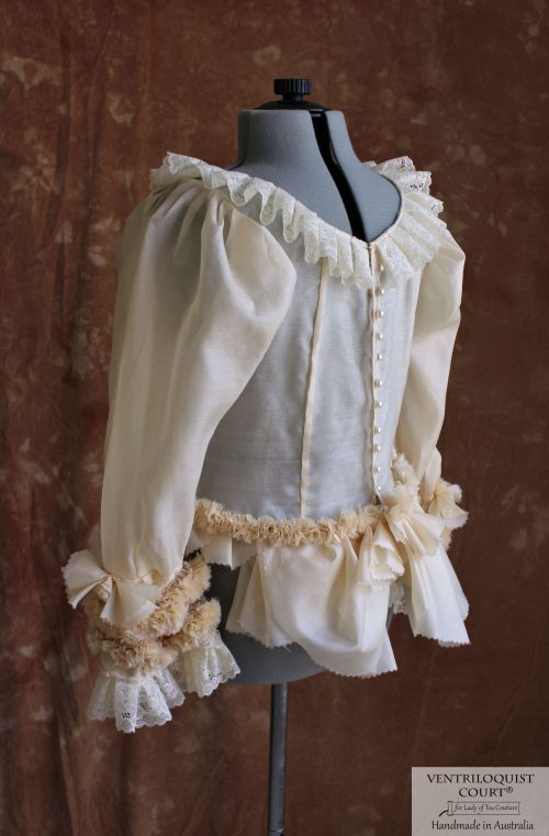 Victorian-style sheer peplum blouse with lace ruffles