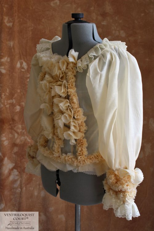Victorian-inspired cream silk peplum blouse